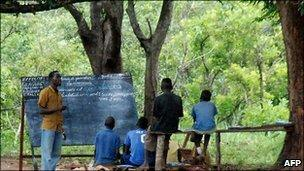 Refugee children from the Democratic Republic of Congo attend class at a makeshift school in the Makpandu camp in the Southern Sudanese region of Western Equatoria (2009)