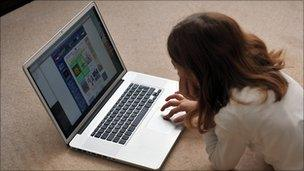 Girl surfing on a laptop
