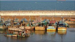 Deep-sea trawler boats stationed along the coast in a fishing village in Tamil Nadu