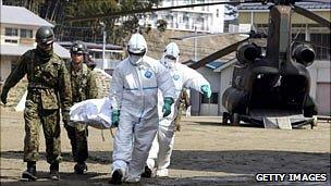 A person is taken by stretcher to a radiation treatment centre in Fukushima prefecture