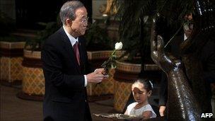 UN Secretary General Ban Ki-moon laying a rose on a peace memorial in Guatemala City