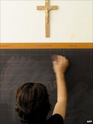 A crucifix hangs in a classroom in Italy (photo taken on July 1, 2010)