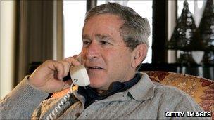 George W Bush making a call from Camp David