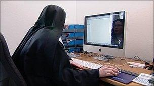 One of the nuns at a computer