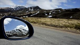 Reflection in a car wing mirror of Glenshee