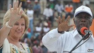 Alassane Ouattara (right) and his wife Dominique in 2009