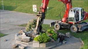Workmen remove the base of the war memorial. Picture by Andre Cleiren from De Wase Koerier