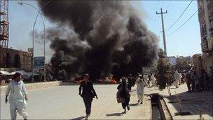Cloud of smoke from burning car in Kandahar (2 April 2011)