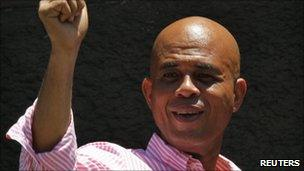 Haiti's presidential candidate Michel Martelly gestures to supporters after casting his ballot during presidential elections in Port-au-Prince in this March 20, 2011 file photo.