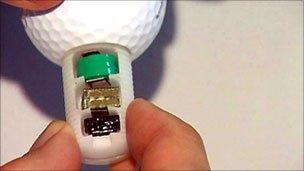 Golf ball with transmitter inside