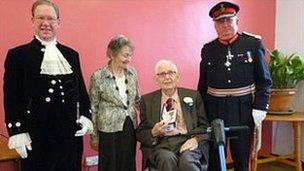 Syd Badland (seated) is pictured with Lloyd FitzHugh, High Sheriff of Clwyd; Mrs Badland and Trefor Jones, Lord-Lieutenant of Clwyd