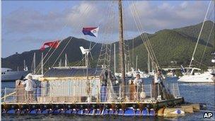 Anthony Smith, right, captains the An-Tiki, as he and crew complete their transatlantic voyage