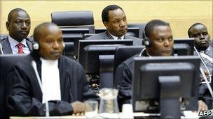Sitting in the back row during the hearing at the ICC on 7/4/11, from left to right: William Ruto, Henry Kosgey and Joshua Arap Sang