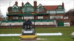 Terry Glover rolling a wicket infront of Liverpool Cricket Club