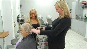 Jackie McNamara and Laurie Brown cutting a customers hair in a local salon