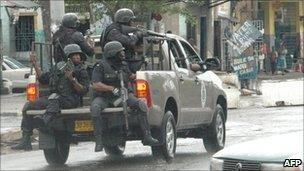 Armed police patrol Kingston, 24 May