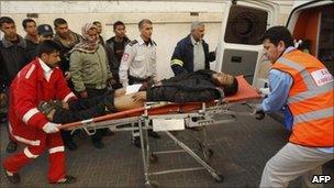 Palestinians wheel an injured man to al-Najar hospital in the southern Gaza Strip, 8