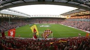 Supporters inside Anfield Stadium