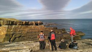 Geology students studying rocks in Wick