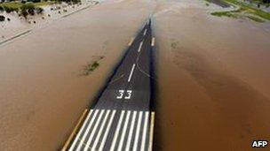 Rising flood waters spread across the runway of the airport at Rockhampton, Australia