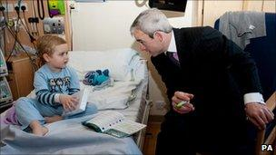 Jockey Ruby Walsh with patient Billy Jarvis at Alder Hey Hospital