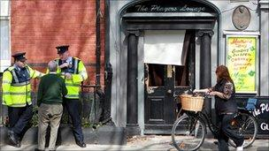 officers outside pub