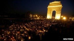 Supporters of Anna Hazare attend a candlelight protest march against corruption in front of India Gate in Delhi April 7, 2011