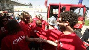 Expedition leader Steve Moore (left, wearing sunglasses) celebrates with the Follow That Fire Engine team members