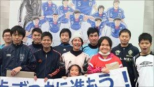 """On 4 April Dai Saito (pictured centre in white) met players and parents of """"Footboze"""", the side he used to coach"""