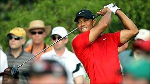 Tiger Woods in action during his final round at the Augusta Masters on Sunday