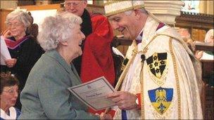 Georgina Jones receiving her award from the Archbishop of Wales