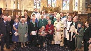 A group shot of award winners with Archbishop and others
