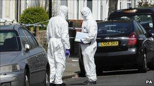 Forensic officers at the scene in Edmonton
