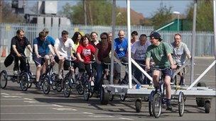 Godiva Awakes bike team with the 'Cyclopedia'. Photo: Andy Moore