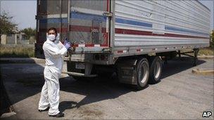 Morgue employee unloading bodies on 8 April, 2011