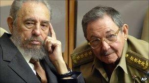 Fidel Castro, left, and his brother Raul, in Cuba, on 1 July, 2004