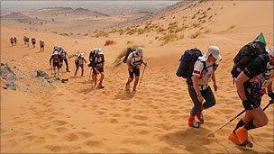 Competitors tackling a sand dune during the 2011 Marathon des Sables