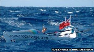 Roz Savage waving from her boat in the Atlantic in 2005