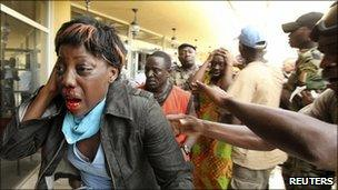 An injured supporter of Ivory Coast's former President Laurent Gbagbo at the Hotel Golf in Abidjan on 11 April 2011