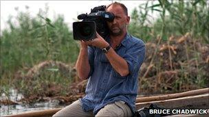 Swanage filmmaker, Stephen Foote, filming in southern Iraq. Copyright of Bruce Chadwick.