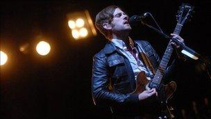 Caleb from Kings of Leon performing at Glastonbury in 2008