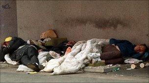 People sleeping rough on the street.