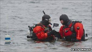 Police divers searching for bodies in waters along Ocean Parkway