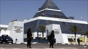 Anti-Riot police stand outside the Sharm El Sheikh hospital treating former President Hosni Mubarak