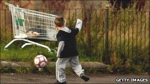 Child playing football (generic)