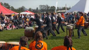 Drummers perform before a crowd