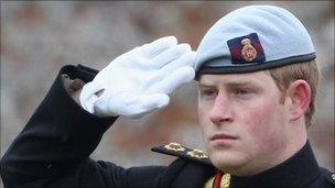 Prince Harry saluting at a memorial