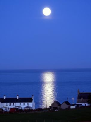 The moon shining over Collieston, Aberdeenshire