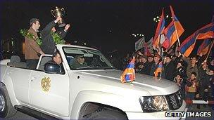 Armenian chess players celebrating a win