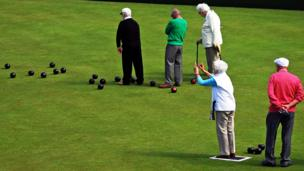 People on a bowling green